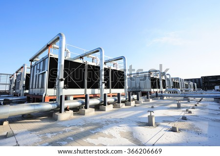 Sets of cooling towers in data center building. #366206669