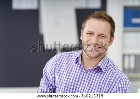Smiling happy confident businessman looking at the camera with a warm beaming smile, close up head and shoulders with copy space #366215318