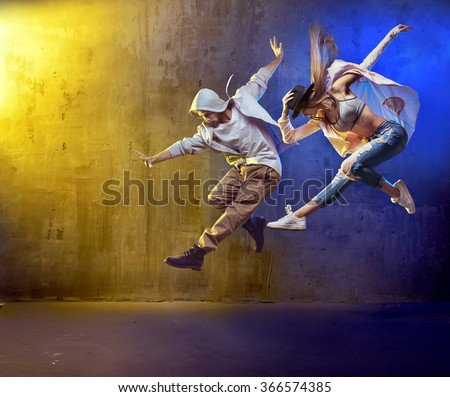 Sporty hip-hop dancers Royalty-Free Stock Photo #366574385