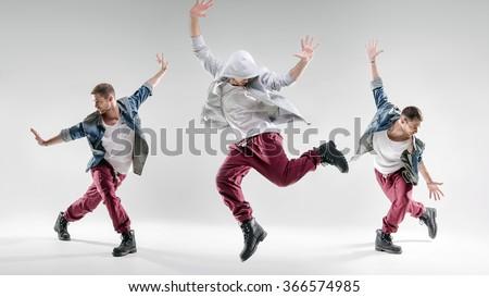 Three hip-hop dancers  Royalty-Free Stock Photo #366574985