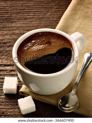 close up of a coffee cup on wooden background #366607400