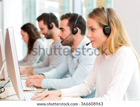 View of a Young attractive woman working in a call center #366608963