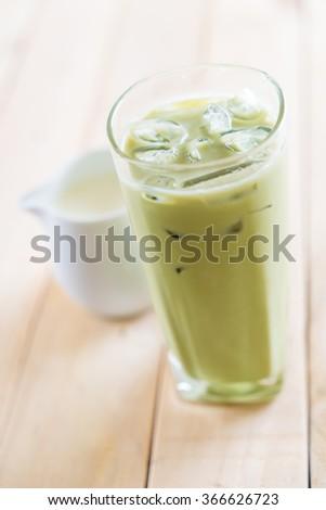 iced matcha latte on wood background #366626723