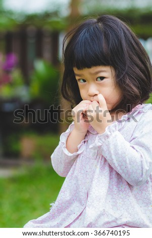 Asian baby cute girl with curly hair eat the fruit #366740195