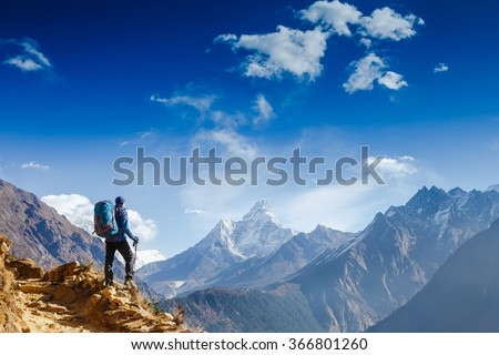 Happy hiker winning reaching life goal, success, freedom and happiness, achievement in mountains. Himalayas. Nepal #366801260