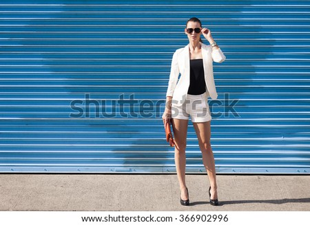 High fashion female model against a blue background.  #366902996