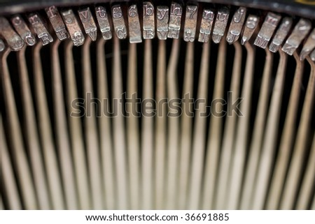 Semi-abstract view of the key strikes (key bars) inside an old fashioned typewriter, of the 1900-1920 era. Photo has been flipped horizontally in Photoshop.