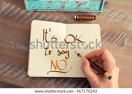 Retro effect and toned image of a woman hand writing a note with a fountain pen on a notebook. Handwritten text IT'S OK TO SAY NO, business success concept #367170242