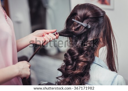 Closeup hairdresser coiffeur makes hairstyle. #367171982