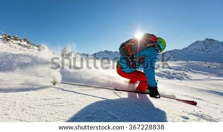 Man freerideer running downhill #367228838