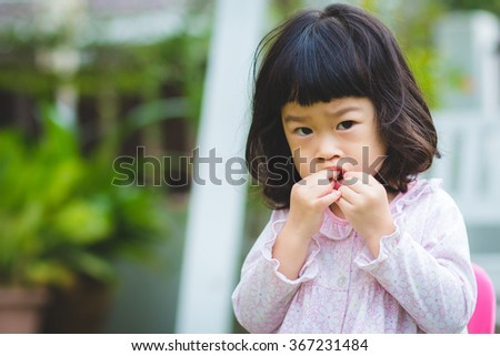 Asian baby cute girl with curly hair eat the fruit #367231484