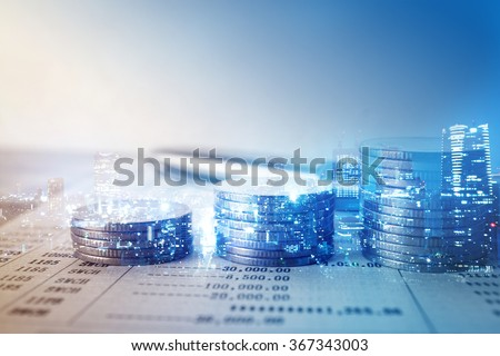 Double exposure of city and rows of coins for finance and banking concept Royalty-Free Stock Photo #367343003