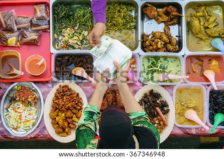 Buying food.Variety of delicious Malaysian home cooked dishes sold at street market stall in Kota Kinabalu Sabah  from top angle view. #367346948