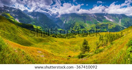 Panorama of Grossglockner mountain range from Grossglockner High Alpine Road. Sunny summer landscape of Austria, Alps, Europe. #367410092