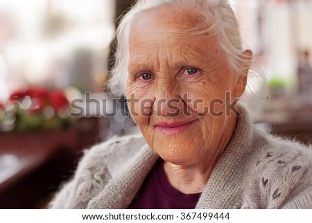 Smiling elderly woman portrait #367499444