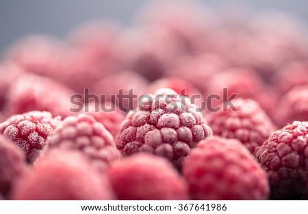 frozen raspberry on dark background Royalty-Free Stock Photo #367641986