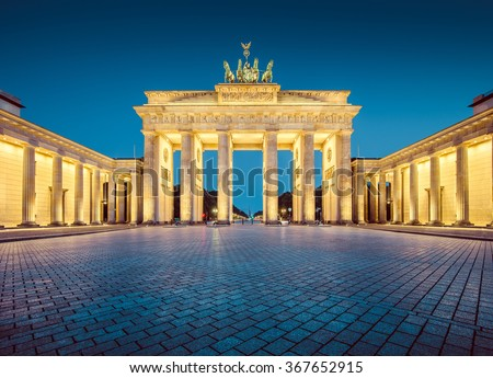 Classic view of famous Brandenburger Tor (Brandenburg Gate), one of the best-known landmarks and national symbols of Germany, in twilight during blue hour at dawn, Berlin, Germany Royalty-Free Stock Photo #367652915
