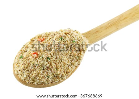 A wooden spoon full of stock booster powder, Beef flavored seasoning with dried vegetable for marinading and making soup