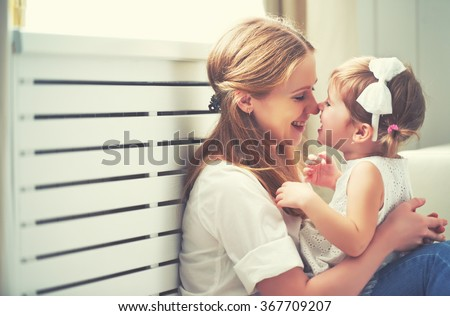 Happy loving family. mother and child girl playing, kissing and hugging #367709207