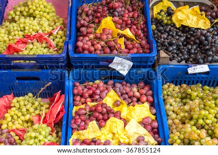 Different kinds of grapes for sale at a market #367855124
