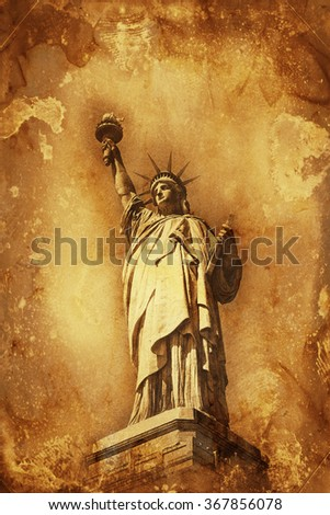 Grunge colorful yellow and brown watercolor paint effect Statue of Liberty holding aloft the torch of Freedom with copy space for a travel or tourism themed concept #367856078