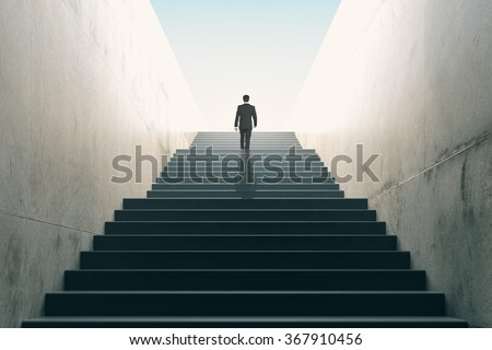 Ambitions concept with businessman climbing stairs  Royalty-Free Stock Photo #367910456