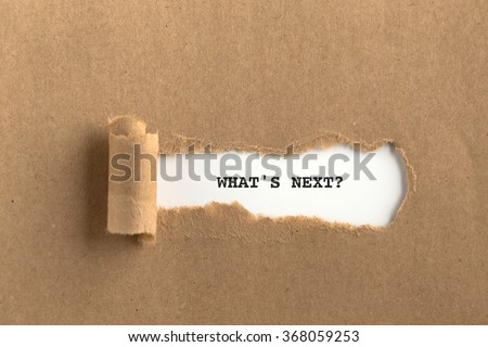 The text WHAT'S NEXT? behind torn brown paper #368059253