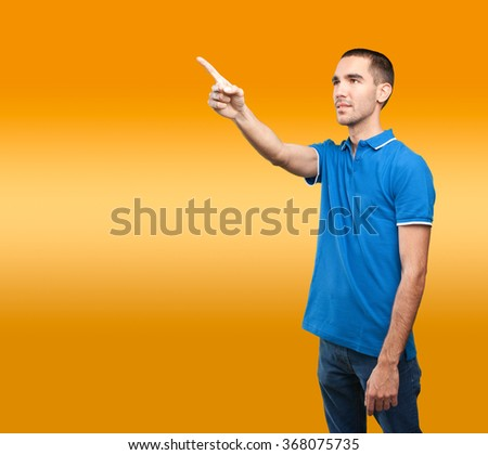 Young man pointing up #368075735