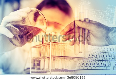 scientist with equipment and science experiments ,Laboratory glassware containing chemical liquid, science research background. Royalty-Free Stock Photo #368080166