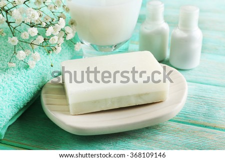 Soap on a dish over wooden background, close up Royalty-Free Stock Photo #368109146