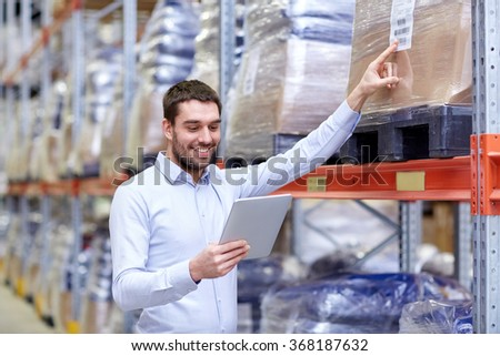happy businessman with tablet pc at warehouse #368187632