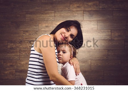 happy mother and daughter hugging at studio #368231015