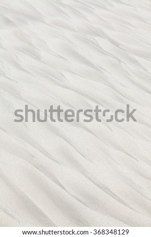 Strange wave-like patterns on the beach sand #368348129