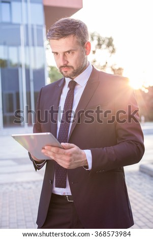 Image of creative male employee with digital tablet #368573984