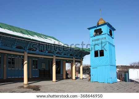 side view of old wooden Dungan Mosque in Oriental-style pagoda, Karakol city, Kyrgyzstan #368646950