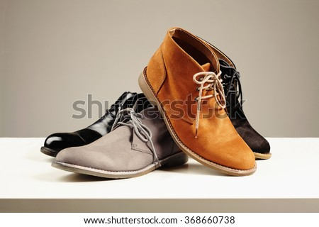 a lot of men's shoes.men fashion still life.boots Royalty-Free Stock Photo #368660738