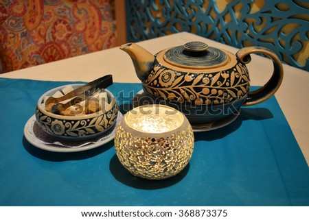 Authentic tea set with handmade mosaic glass candle cup