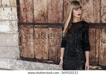 Beautiful woman in black dress, looking away Royalty-Free Stock Photo #369030212