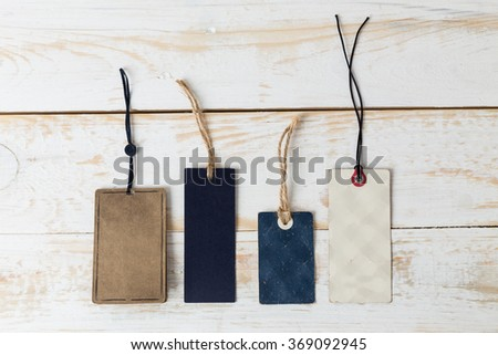 Labels, tags on wooden background #369092945