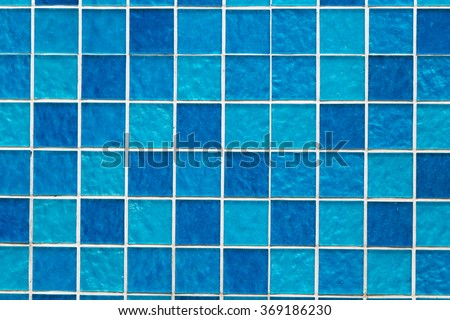 Gradient blue colored mosaic background tiles