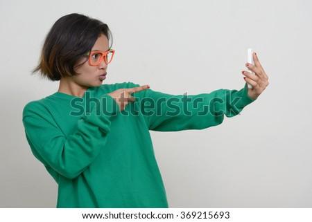 Nerd girl using mobile phone #369215693