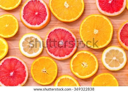 Sliced citrus on a bamboo napkin close up. #369322838