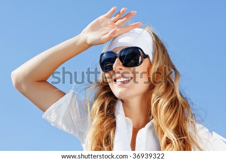 Beautiful young girl over blue sky #36939322