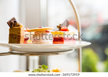 English afternoon tea desserts with beautiful breakfast snacks Royalty-Free Stock Photo #369573959