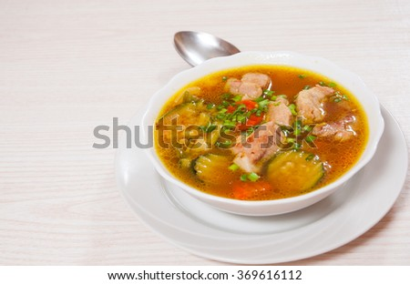 Meat soup with vegetables #369616112