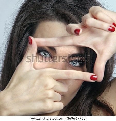 close-up portrait of young charming brunette on the light background studio #369667988
