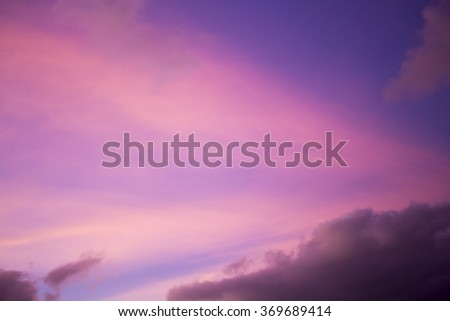 Clouds at sunset in tropical Broome, North Western Australia  are beautifully hued with mauve, pink, yellow, russet, orange, grey and blue tones as the hot sun sinks into the Indian Ocean  in summer. #369689414