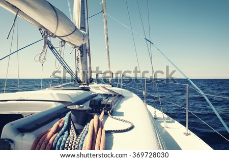 sailing yacht in an open sea, retro style photo #369728030