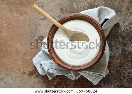 Homemade yogurt or sour cream in a rustic bowl #369768824