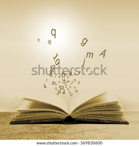 Open book with flying letters. Concept of the importance of reading. Sepia tones. #369830600